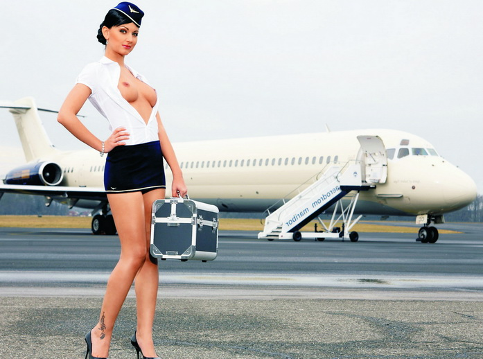 Istanbul escort girl on the plane is sitting and reading a magazine, a girl with no clothes on preparing for flight, depraved woman naked in a chair of the aircraft is ready for adventure, naked girl on the plane, beautiful girl