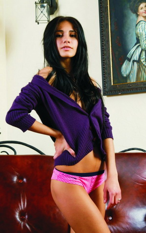 Escort Istanbul girl Nastya is in the room, wearing a thin sweater, which barely covers her breasts, fragile shoulders are parted, they are under the cascade of the girls' black gorgeous hair, her legs are shaped well and her private parts are covered only by thin pink panties that you are allowed to take off