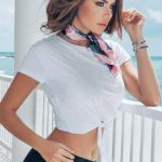 Ukraynalı escort Istanbul girl is standing on a balcony wearing the stylish outfit of the 1950s