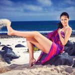 Incall escorts in Istanbul girl is throwing some sand away with her foot, smiling along with that