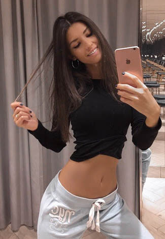Escort girl near me is taking a selfie on an iPhone – which says she's good for sex, not for chat