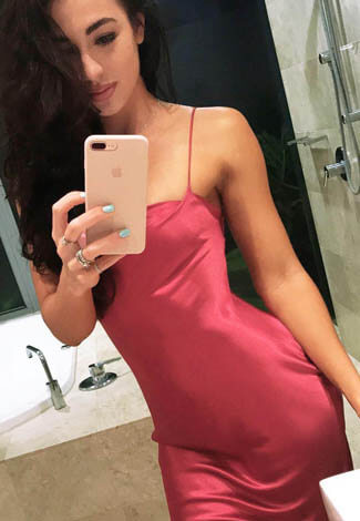 Istanbul sex girl is standing in the nightgown of rosy color to show how tender she can be