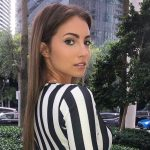Escort agency in Istanbul lover wears super elegant black-and-white suit & has immaculate makeup