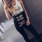 Istanbul escort girl is standing in a toilet and taking a selfie to show her sportiness and youth