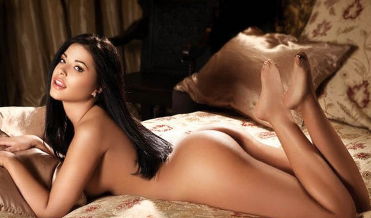 Escorts in Istanbul girl lies on a bed without clothes and enjoys the beauty of her slim body