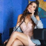 Escort services Istanbul woman is calling on the phone sitting in a very rich blue-golden interior