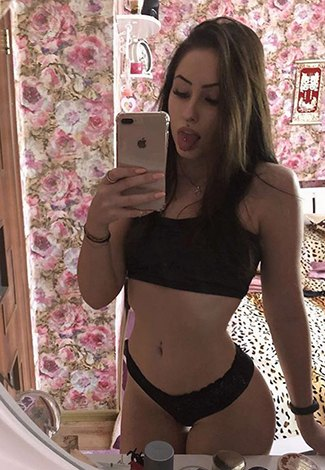 VIP escort Istanbul girl takes a selfie on Apple product & shows a tongue protruding out of a mouth