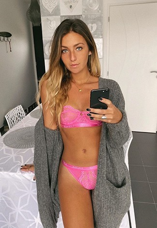 Cheap escorts in Istanbul woman is wearing a gray pullover with pink underwear