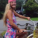 Escort girl Istanbul is riding a bike and gives one of the most sincere smiles that we've ever seen
