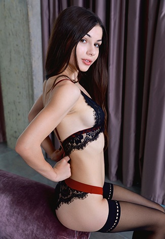 Istanbul escort girl holds a thin lacy bra – help her get rid of it