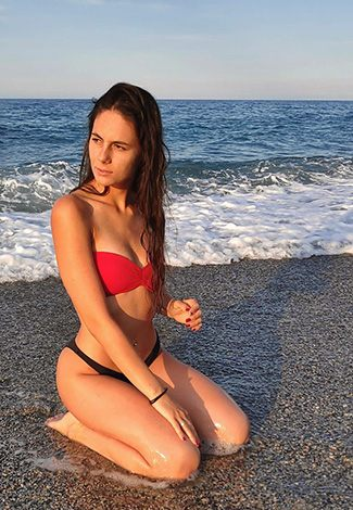 Istanbul escort servisi gal wears a red top and black panties