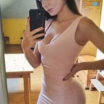 Escorts in Istanbul girl delights us with a body-tight beige dress
