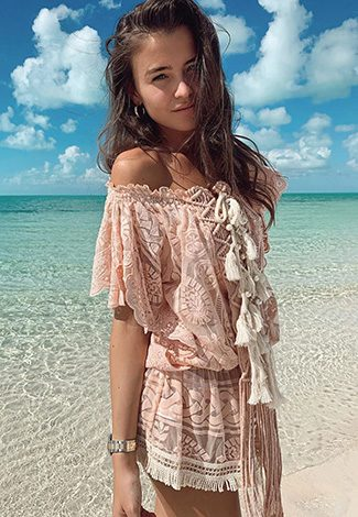 Elit VIP escort dresses a beige summer dress perfect for a beach time