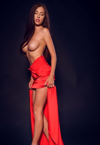 Independent escorts in Turkey lover is standing in a way to show naked boobs and legs