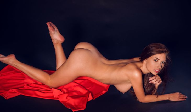 Independent escorts in Turkey lover shows her naked body, lying in a seductive manner on a dress