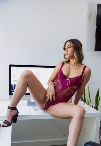 Russian outcall woman has sat atop of the working table to demonstrate her body and pussy