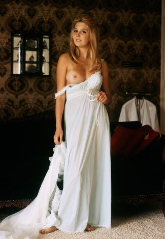 Istanbul VIP escortlar woman in white is standing in the room with one boob exposed