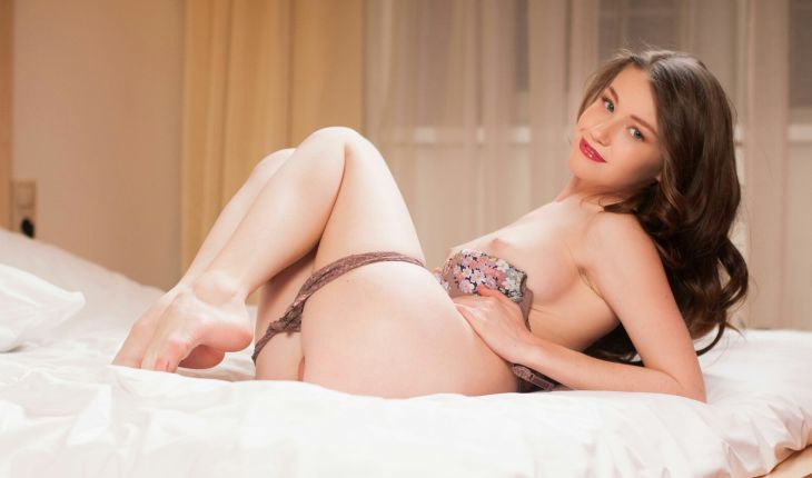Ukranian escort in Turkey mistress is on her back in the bed, showing a top of her uncovered labia